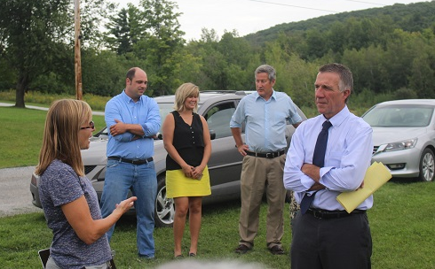 RIDGELINE DEFENDERS: Local resident Christine Lang and Republican gubernatorial candidate Phil Scott discuss their opposition to a proposal to build seven giant wind turbines on Rocky Ridge behind them.
